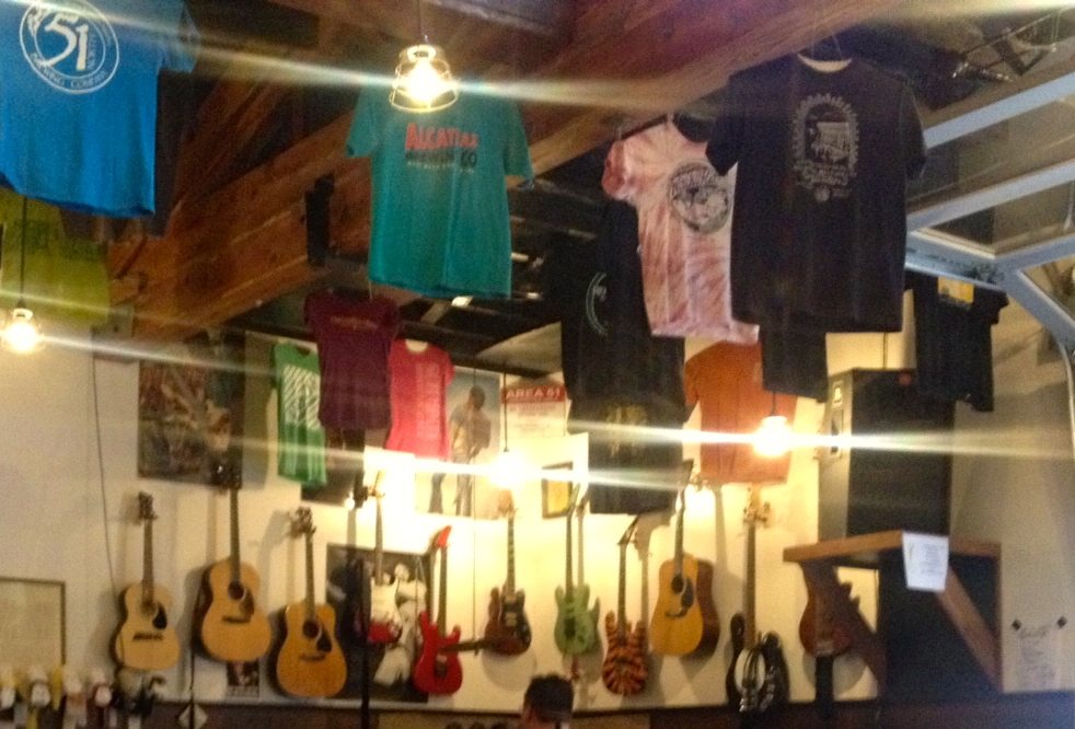 The t-shirts hanging from the ceiling!